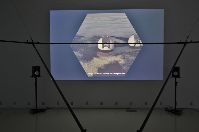 Exhibition view – in the foreground: Summit of Gods, two-channel video installation, 2019. | Photo: Miklós Surányi