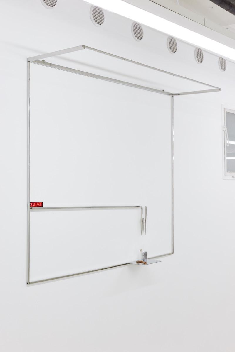 Dorota Gawęda and Eglė Kulbokaitė: Leave no trace I, 2018. Polished stainless steel, myrrh, LED, sampling bottle, headspace needle, saliva, lighter; 140 x 120 x 40 cm | photo: Dávid Biró